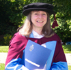 Pat Harris receiving her doctorate for her studies into astrology and fertility